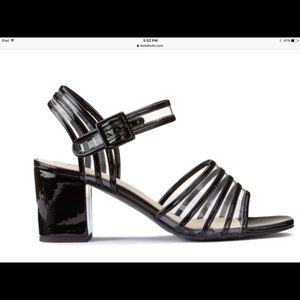 Black patent and pvc block heels from France.